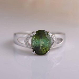 Shop Green Tourmaline Rings! Green Tourmaline Ring Oval Cut Engagement Ring White Gold Micro Pave Diamond Solitaire Ring Birthstone Minimalist Engraving Wedding Ring | Natural genuine Green Tourmaline rings, simple unique alternative gemstone engagement rings. #rings #jewelry #bridal #wedding #jewelryaccessories #engagementrings #weddingideas #affiliate #ad
