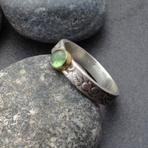 Shop Green Tourmaline Jewelry! Green tourmaline ring, round stone set in an 18 karat gold bezel, thick textured sterling silver band leaf vine design, size 8 and 3/4 | Natural genuine Green Tourmaline jewelry. Buy crystal jewelry, handmade handcrafted artisan jewelry for women.  Unique handmade gift ideas. #jewelry #beadedjewelry #beadedjewelry #gift #shopping #handmadejewelry #fashion #style #product #jewelry #affiliate #ad