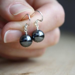 Hematite Earrings . Healing Stone for Anxiety Relief Earrings . Dark Grey Earring . Silver Ball Earrings | Natural genuine Gemstone jewelry. Buy crystal jewelry, handmade handcrafted artisan jewelry for women.  Unique handmade gift ideas. #jewelry #beadedjewelry #beadedjewelry #gift #shopping #handmadejewelry #fashion #style #product #jewelry #affiliate #ad