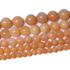 Shop Jade Round Beads! Natural Yellow Jade Beads Undyed Round Smooth Yellow Jade Beads 6mm 8mm 10mm 12mm Old Jade Strands for Jewlery Making | Natural genuine round Jade beads for beading and jewelry making.  #jewelry #beads #beadedjewelry #diyjewelry #jewelrymaking #beadstore #beading #affiliate #ad
