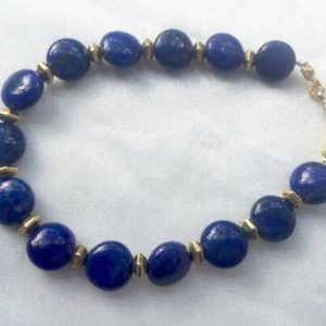 Shop Lapis Lazuli Bracelets! Simple, Art Deco-inspired lapis lazuli & brass bracelet. Rich royal blue gemstones. Geometric jewely with casual, everyday style | Natural genuine Lapis Lazuli bracelets. Buy crystal jewelry, handmade handcrafted artisan jewelry for women.  Unique handmade gift ideas. #jewelry #beadedbracelets #beadedjewelry #gift #shopping #handmadejewelry #fashion #style #product #bracelets #affiliate #ad