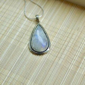 Shop Rainbow Moonstone Pendants! Teardrop Statement Rainbow Moonstone Shine Sterling Silver Pendant // Rainbow Moonstone Silver Pendant Necklace // Rainbow Moonstone | Natural genuine Rainbow Moonstone pendants. Buy crystal jewelry, handmade handcrafted artisan jewelry for women.  Unique handmade gift ideas. #jewelry #beadedpendants #beadedjewelry #gift #shopping #handmadejewelry #fashion #style #product #pendants #affiliate #ad