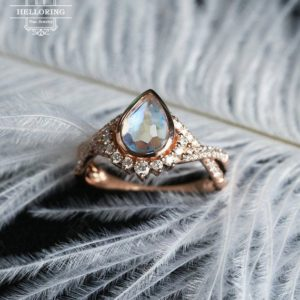 Moonstone engagement ring Rose gold engagement ring Women Wedding Diamond/Moissanite Vintage ring Pear shaped Twisted Bridal Jewelry | Natural genuine Moonstone rings, simple unique alternative gemstone engagement rings. #rings #jewelry #bridal #wedding #jewelryaccessories #engagementrings #weddingideas #affiliate #ad