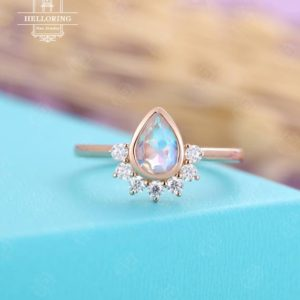 Shop Moonstone Rings! Pear shaped Moonstone Engagement ring rose gold, vintage ring for women, unique moissanite ring, bridal jewelry,Anniversary gifts for her | Natural genuine Moonstone rings, simple unique alternative gemstone engagement rings. #rings #jewelry #bridal #wedding #jewelryaccessories #engagementrings #weddingideas #affiliate #ad