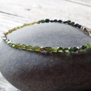 ombre green tourmaline bracelet, gold filled accents, stacking bracelet for men and women, custom size, made to order | Natural genuine Green Tourmaline bracelets. Buy handcrafted artisan men's jewelry, gifts for men.  Unique handmade mens fashion accessories. #jewelry #beadedbracelets #beadedjewelry #shopping #gift #handmadejewelry #bracelets #affiliate #ad