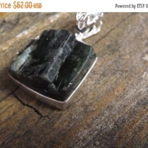 Shop Green Tourmaline Pendants! MOTHERS DAY SALE Healing Green Tourmaline Rough Crystal sterling silver pendant | Natural genuine Green Tourmaline pendants. Buy crystal jewelry, handmade handcrafted artisan jewelry for women.  Unique handmade gift ideas. #jewelry #beadedpendants #beadedjewelry #gift #shopping #handmadejewelry #fashion #style #product #pendants #affiliate #ad