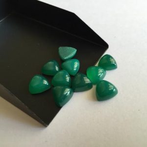 Shop Onyx Cabochons! 10 Pieces 10x10mm Each Green Onyx Trillion Shaped Smooth Flat Back Green Color Loose Cabochons GO6 | Natural genuine stones & crystals in various shapes & sizes. Buy raw cut, tumbled, or polished gemstones for making jewelry or crystal healing energy vibration raising reiki stones. #crystals #gemstones #crystalhealing #crystalsandgemstones #energyhealing #affiliate #ad