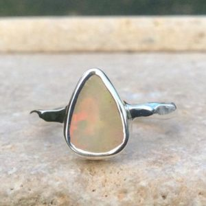Shop Opal Rings! Raw Ethiopian Opal Silver Ring, Rough Natural Gemstone Ring, Bride and Bridesmaids Jewellery | Natural genuine Opal rings, simple unique handcrafted gemstone rings. #rings #jewelry #shopping #gift #handmade #fashion #style #affiliate #ad