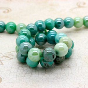 Shop Opal Beads! Moss Green Opal, Natural Moss Green Opal Smooth Round Sphere Ball Loose Gemstone Beads | Natural genuine beads Opal beads for beading and jewelry making.  #jewelry #beads #beadedjewelry #diyjewelry #jewelrymaking #beadstore #beading #affiliate #ad
