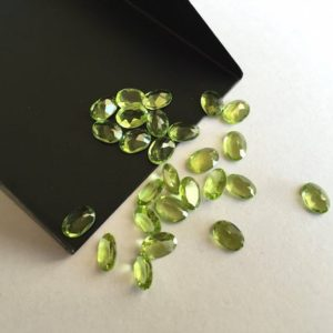Shop Peridot Stones & Crystals! 100 Pieces Wholesale 7x5mm Green Peridot Flat Back Oval Shaped Faceted Loose Gemstones SKU-P4 | Natural genuine stones & crystals in various shapes & sizes. Buy raw cut, tumbled, or polished gemstones for making jewelry or crystal healing energy vibration raising reiki stones. #crystals #gemstones #crystalhealing #crystalsandgemstones #energyhealing #affiliate #ad