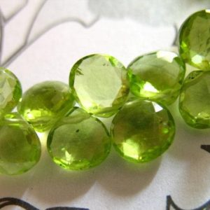 Shop Peridot Bead Shapes! Peridot Heart Briolettes, Luxe AAA, 6-6.5 mm, Granny Apple Green Focals, faceted.. August birthstone 67 | Natural genuine other-shape Peridot beads for beading and jewelry making.  #jewelry #beads #beadedjewelry #diyjewelry #jewelrymaking #beadstore #beading #affiliate #ad