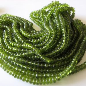 Shop Peridot Rondelle Beads! 5 Strands Wholesale Beautiful Natural Rare Peridot Smooth Rondelle Beads 4mm To 7mm Beads 18 Inch Strand SKU2767/3 | Natural genuine rondelle Peridot beads for beading and jewelry making.  #jewelry #beads #beadedjewelry #diyjewelry #jewelrymaking #beadstore #beading #affiliate #ad