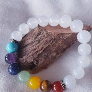 Shop Chakra Beads! Quartz and chakra beaded gemstone stretch bracelet | hand made jewelry | healing crystal | energy healing | metaphysical stones | Shop jewelry making and beading supplies, tools & findings for DIY jewelry making and crafts. #jewelrymaking #diyjewelry #jewelrycrafts #jewelrysupplies #beading #affiliate #ad