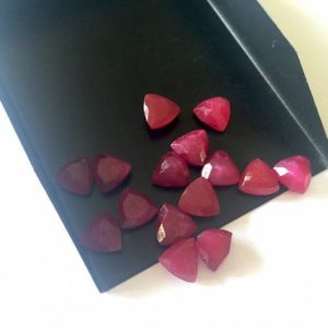 Shop Ruby Cabochons! 50 Pieces Wholesale 8mm Each Calibrated Red Corundum Trillion Shaped Gemstone Loose Cabochons, Faceted Ruby Cabochons For Jewelry, SKU-RC1 | Natural genuine stones & crystals in various shapes & sizes. Buy raw cut, tumbled, or polished gemstones for making jewelry or crystal healing energy vibration raising reiki stones. #crystals #gemstones #crystalhealing #crystalsandgemstones #energyhealing #affiliate #ad