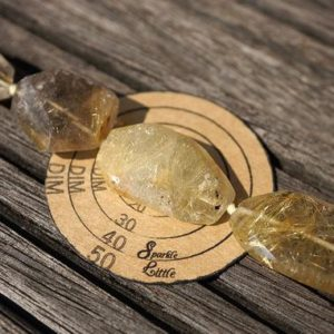 Shop Rutilated Quartz Faceted Beads! Rutilated Quartz 13-26mm faceted beads (ETB00743) | Natural genuine faceted Rutilated Quartz beads for beading and jewelry making.  #jewelry #beads #beadedjewelry #diyjewelry #jewelrymaking #beadstore #beading #affiliate #ad