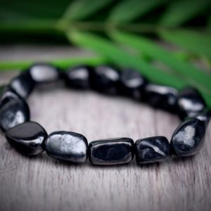 Shop Shungite Bracelets! SHUNGITE EMF PROTECTION Genuine Shungite Pebble Nugget Bracelet Black Bead 7 in. 12mm Tumbled Bracelet Small, Medium, Large | Natural genuine Shungite bracelets. Buy crystal jewelry, handmade handcrafted artisan jewelry for women.  Unique handmade gift ideas. #jewelry #beadedbracelets #beadedjewelry #gift #shopping #handmadejewelry #fashion #style #product #bracelets #affiliate #ad