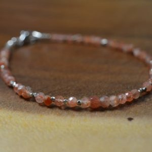 Shop Sunstone Bracelets! Delicate Sunstone Bead Bracelet In 14k Gold Fill, Sterling Silver / / Stacking Bracelet / / Summer Jewelry / / Hill Tribe Bead Accent / / Layer | Natural genuine Sunstone bracelets. Buy crystal jewelry, handmade handcrafted artisan jewelry for women.  Unique handmade gift ideas. #jewelry #beadedbracelets #beadedjewelry #gift #shopping #handmadejewelry #fashion #style #product #bracelets #affiliate #ad