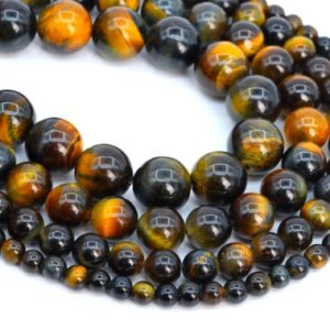 Shop Tiger Eye Round Beads! Genuine Natural Yellow Blue Tiger Eye Loose Beads Grade AAA Round Shape 6mm 7-8mm 10mm | Natural genuine round Tiger Eye beads for beading and jewelry making.  #jewelry #beads #beadedjewelry #diyjewelry #jewelrymaking #beadstore #beading #affiliate #ad