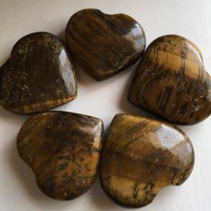 Shop Tiger Eye Shapes! Tiger's Eye Gemstone Puffy Heart, Healing Stone, Healing Crystals,Chakra Stone, Spiritual Stone | Natural genuine stones & crystals in various shapes & sizes. Buy raw cut, tumbled, or polished gemstones for making jewelry or crystal healing energy vibration raising reiki stones. #crystals #gemstones #crystalhealing #crystalsandgemstones #energyhealing #affiliate #ad