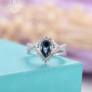Shop Topaz Rings! Pear shaped London Blue Topaz Engagement ring set, white gold ,Vintage wedding ring, Curved diamond/ Moissanite band, Anniversary | Natural genuine Topaz rings, simple unique alternative gemstone engagement rings. #rings #jewelry #bridal #wedding #jewelryaccessories #engagementrings #weddingideas #affiliate #ad