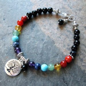 Shop Chakra Bracelets! Tree of Life Chakra Bracelet – 7 Chakra Gemstones & Black Agate, Metaphysical Jewelry | Shop jewelry making and beading supplies, tools & findings for DIY jewelry making and crafts. #jewelrymaking #diyjewelry #jewelrycrafts #jewelrysupplies #beading #affiliate #ad