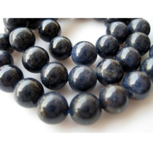 Shop Sapphire Round Beads! 8mm Smooth Blue Sapphire Round Beads/ Sapphire Beads/ 8mm Beads/ 52 Pieces Approx/ 16 Inch Strand | Natural genuine round Sapphire beads for beading and jewelry making.  #jewelry #beads #beadedjewelry #diyjewelry #jewelrymaking #beadstore #beading #affiliate #ad