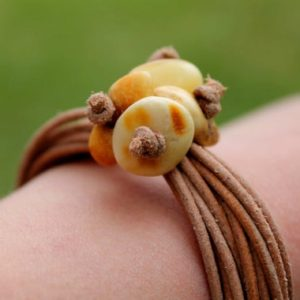 Shop Amber Bracelets! Leather Bracelet White Amber Organic Zen Jewelry Earthy Color Brown Tan Yellow Summer Fashion | Natural genuine Amber bracelets. Buy crystal jewelry, handmade handcrafted artisan jewelry for women.  Unique handmade gift ideas. #jewelry #beadedbracelets #beadedjewelry #gift #shopping #handmadejewelry #fashion #style #product #bracelets #affiliate #ad