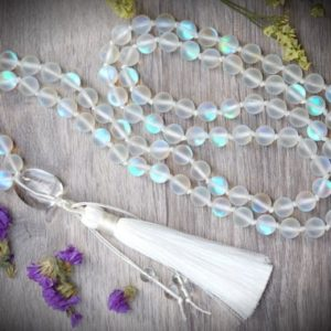 Shop Angel Aura Quartz Necklaces! Matte Mystic Rainbow Angel Aura Mermaid Quartz 8mm 108 Bead Hand Knotted Crystal Clear Quartz White Tassel Meditation Necklace | Natural genuine Angel Aura Quartz necklaces. Buy crystal jewelry, handmade handcrafted artisan jewelry for women.  Unique handmade gift ideas. #jewelry #beadednecklaces #beadedjewelry #gift #shopping #handmadejewelry #fashion #style #product #necklaces #affiliate #ad