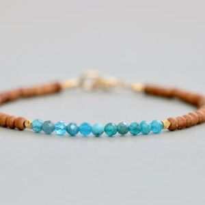 Shop Apatite Bracelets! Apatite and Sandalwood Bracelet Handmade Bracelet Beaded Bracelet Gemstone Bracelet Gift for Her | Natural genuine Apatite bracelets. Buy crystal jewelry, handmade handcrafted artisan jewelry for women.  Unique handmade gift ideas. #jewelry #beadedbracelets #beadedjewelry #gift #shopping #handmadejewelry #fashion #style #product #bracelets #affiliate #ad