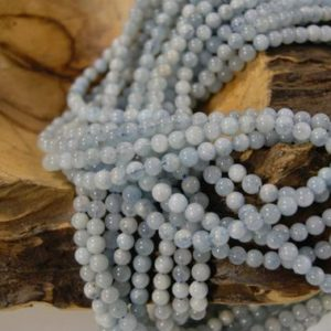 Shop Aquamarine Round Beads! Aquamarine Smooth Round Natural 6mm Gemstone Bead-15.5 inch strand- | Natural genuine round Aquamarine beads for beading and jewelry making.  #jewelry #beads #beadedjewelry #diyjewelry #jewelrymaking #beadstore #beading #affiliate #ad