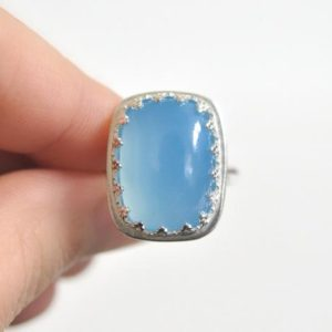 Shop Blue Chalcedony Rings! Blue Chalcedony Ring- Sterling Silver Ring- Statement Jewelry- Unique Cocktail Ring- Ocean Blue Gemstone Ring- Rectangular Sky Blue Gemstone | Natural genuine Blue Chalcedony rings, simple unique handcrafted gemstone rings. #rings #jewelry #shopping #gift #handmade #fashion #style #affiliate #ad