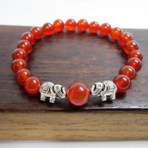 Shop Carnelian Bracelets! Carnelian Elephant Bracelet Sacral Chakra Elephant Bracelet Healing Carnelian Yoga Bracelet Carnelian Good Luck Bracelet Carnelian Elephant | Natural genuine Carnelian bracelets. Buy crystal jewelry, handmade handcrafted artisan jewelry for women.  Unique handmade gift ideas. #jewelry #beadedbracelets #beadedjewelry #gift #shopping #handmadejewelry #fashion #style #product #bracelets #affiliate #ad