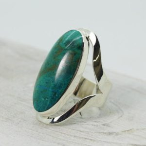 Shop Chrysocolla Rings! Amazing Chrysocolla ring stone oval cabochon stone look like  set on 925e sterling silver Oval ring genuine natural Chrysocolla stone | Natural genuine Chrysocolla rings, simple unique handcrafted gemstone rings. #rings #jewelry #shopping #gift #handmade #fashion #style #affiliate #ad