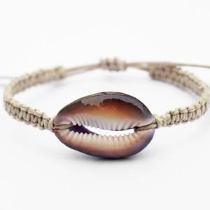 Shop Hemp Jewelry! Cowrie Shell Bracelet / Large Cowry Bracelet / Ocean Bracelet / Unisex Surfer Bracelet / Boho Beach Jewelry / Natural Macrame Hemp Jewelry | Shop jewelry making and beading supplies, tools & findings for DIY jewelry making and crafts. #jewelrymaking #diyjewelry #jewelrycrafts #jewelrysupplies #beading #affiliate #ad