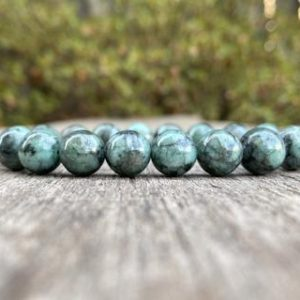 Shop Emerald Bracelets! Chunky Emerald Bracelet 10mm Natural Emerald with Black Inclusion Beaded Gemstone Bracelet Love & Contentment Bracelet Jewelry Gift Bracelet | Natural genuine Emerald bracelets. Buy crystal jewelry, handmade handcrafted artisan jewelry for women.  Unique handmade gift ideas. #jewelry #beadedbracelets #beadedjewelry #gift #shopping #handmadejewelry #fashion #style #product #bracelets #affiliate #ad