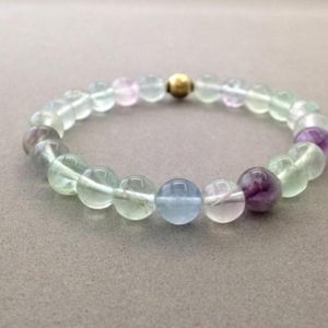 Shop Fluorite Bracelets! 8mm Multi-Colored Rainbow Fluorite Stretch Bead Bracelet with Brass Accent Bead | Natural genuine Fluorite bracelets. Buy crystal jewelry, handmade handcrafted artisan jewelry for women.  Unique handmade gift ideas. #jewelry #beadedbracelets #beadedjewelry #gift #shopping #handmadejewelry #fashion #style #product #bracelets #affiliate #ad