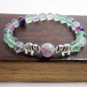 Shop Fluorite Bracelets! Fluorite Elephant Bracelet Crown Chakra Elephant Bracelet Healing Fluorite Yoga Bracelet Fluorite Good Luck Bracelet Fluorite Elephant Luck | Natural genuine Fluorite bracelets. Buy crystal jewelry, handmade handcrafted artisan jewelry for women.  Unique handmade gift ideas. #jewelry #beadedbracelets #beadedjewelry #gift #shopping #handmadejewelry #fashion #style #product #bracelets #affiliate #ad