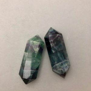 Shop Fluorite Points & Wands! Double Terminated Rainbow Fluorite Point Carving | Natural genuine stones & crystals in various shapes & sizes. Buy raw cut, tumbled, or polished gemstones for making jewelry or crystal healing energy vibration raising reiki stones. #crystals #gemstones #crystalhealing #crystalsandgemstones #energyhealing #affiliate #ad