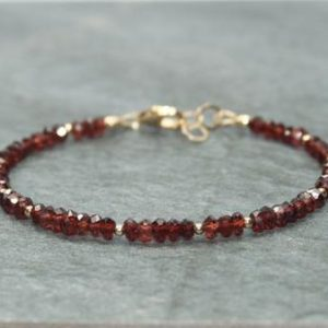 Shop Garnet Bracelets! Garnet Bracelet, Garnet Jewelry, Gold Filled Beads, Layering, January Birthstone, Gemstone Jewelry | Natural genuine Garnet bracelets. Buy crystal jewelry, handmade handcrafted artisan jewelry for women.  Unique handmade gift ideas. #jewelry #beadedbracelets #beadedjewelry #gift #shopping #handmadejewelry #fashion #style #product #bracelets #affiliate #ad
