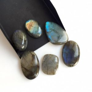 Shop Labradorite Cabochons! 5 Pieces 30mm to 20mm Each Mix Shaped Labradorite Gemstone Loose Cabochons, Black with flashes of blue Labradorite Cabochons, SKU-L4 | Natural genuine stones & crystals in various shapes & sizes. Buy raw cut, tumbled, or polished gemstones for making jewelry or crystal healing energy vibration raising reiki stones. #crystals #gemstones #crystalhealing #crystalsandgemstones #energyhealing #affiliate #ad
