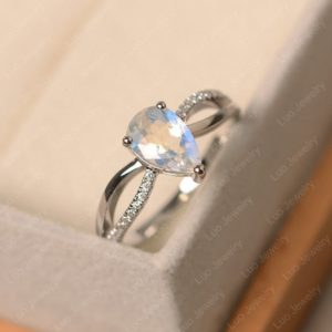 Shop Moonstone Engagement Rings! Moonstone ring, June birthstone ring, pear cut blue gemstone ring, sterling silver engagement ring | Natural genuine Moonstone rings, simple unique alternative gemstone engagement rings. #rings #jewelry #bridal #wedding #jewelryaccessories #engagementrings #weddingideas #affiliate #ad
