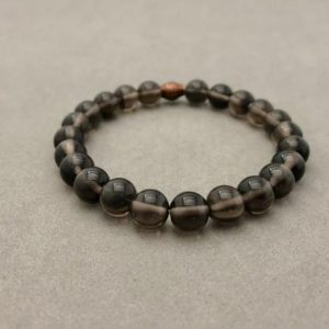 Shop Obsidian Bracelets! Midnight Obsidian Stretch Bead Bracelet with Copper Accent Bead | Natural genuine Obsidian bracelets. Buy crystal jewelry, handmade handcrafted artisan jewelry for women.  Unique handmade gift ideas. #jewelry #beadedbracelets #beadedjewelry #gift #shopping #handmadejewelry #fashion #style #product #bracelets #affiliate #ad