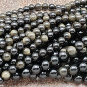 Shop Obsidian Round Beads! 4.5mm or 6.5mm or 8mm Golden Black Obsidian Polished Round Beads, 15 inch   Natural genuine round Obsidian beads for beading and jewelry making.  #jewelry #beads #beadedjewelry #diyjewelry #jewelrymaking #beadstore #beading #affiliate #ad