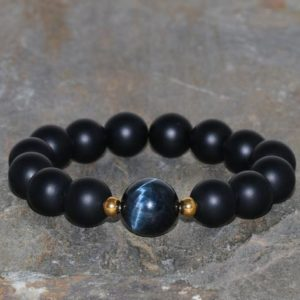 Shop Onyx Jewelry! Black Onyx and Hawk's Eye Bracelet Handmade 12mm Matte Black Onyx, 14mm Hawk Eye Guru Stone Natural Beaded Gemstone Bracelet Unisex Bracelet | Natural genuine Onyx jewelry. Buy crystal jewelry, handmade handcrafted artisan jewelry for women.  Unique handmade gift ideas. #jewelry #beadedjewelry #beadedjewelry #gift #shopping #handmadejewelry #fashion #style #product #jewelry #affiliate #ad