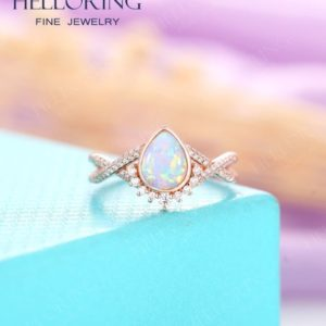 Shop Opal Rings! Vintage Lab Opal Engagement ring rose gold for Women, Pear shaped wedding ring Halo diamond/moissanite,Anniversary Gifts for her | Natural genuine Opal rings, simple unique alternative gemstone engagement rings. #rings #jewelry #bridal #wedding #jewelryaccessories #engagementrings #weddingideas #affiliate #ad