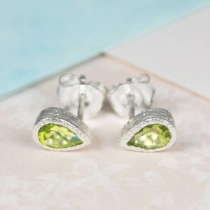 Shop Peridot Earrings! Silver Gemstone Studs, Sterling Silver Studs, Green Peridot Stone Earrings, Green Gemstone Earrings, Teardrop Earrings, Earrings Under 30 | Natural genuine Peridot earrings. Buy crystal jewelry, handmade handcrafted artisan jewelry for women.  Unique handmade gift ideas. #jewelry #beadedearrings #beadedjewelry #gift #shopping #handmadejewelry #fashion #style #product #earrings #affiliate #ad