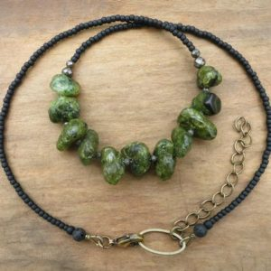 Shop Peridot Necklaces! Rough Green Peridot Necklace, raw peridot pebble August birthstone jewelry, Bohemian tribal hippie beaded stone jewelry | Natural genuine Peridot necklaces. Buy crystal jewelry, handmade handcrafted artisan jewelry for women.  Unique handmade gift ideas. #jewelry #beadednecklaces #beadedjewelry #gift #shopping #handmadejewelry #fashion #style #product #necklaces #affiliate #ad
