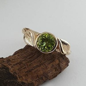 Shop Peridot Rings! 6.5mm Round Peridot Engagement Ring – Leaf and Twig Engagement Ring – Promise Ring – Unique Engagement Ring – Gemstone Ring | Natural genuine Peridot rings, simple unique alternative gemstone engagement rings. #rings #jewelry #bridal #wedding #jewelryaccessories #engagementrings #weddingideas #affiliate #ad