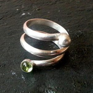 Shop Peridot Rings! Silver Spiral Coil Ring with Peridot sterling silver spiral ring | Natural genuine Peridot rings, simple unique handcrafted gemstone rings. #rings #jewelry #shopping #gift #handmade #fashion #style #affiliate #ad