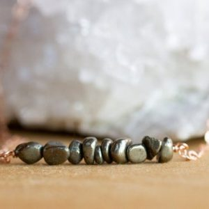 Shop Pyrite Pendants! Raw Pyrite Necklace – Fools Gold Necklace – Pyrite Pendant – Pyrite Choker – Gemstone Jewelry – Pyrite Jewelry – Daity Gemstone Necklace   Natural genuine Pyrite pendants. Buy crystal jewelry, handmade handcrafted artisan jewelry for women.  Unique handmade gift ideas. #jewelry #beadedpendants #beadedjewelry #gift #shopping #handmadejewelry #fashion #style #product #pendants #affiliate #ad